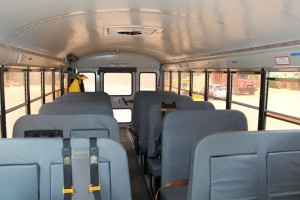 Mid-size bus inside school_bus charter_bus